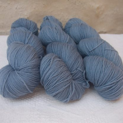 Glaucous - Light to mid-tone glaucous grey 4-ply/fingering Peruvian Highland wool sock yarn. Hand-dyed by Triskelion Yarn.