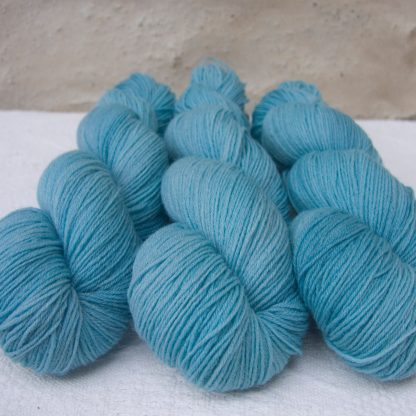 Horizon - Light azure blue 4-ply/fingering Peruvian Highland wool sock yarn. Hand-dyed by Triskelion Yarn.