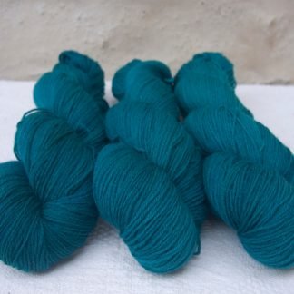 Llŷr - Dark blue green 4-ply/fingering Peruvian Highland wool sock yarn. Hand-dyed by Triskelion Yarn.