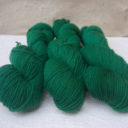 Nemeton - Mid-tone emerald green 4-ply/fingering Peruvian Highland wool sock yarn. Hand-dyed by Triskelion Yarn.