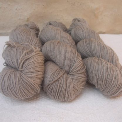 Pebble - Pale greyish brown 4-ply/fingering Peruvian Highland wool sock yarn. Hand-dyed by Triskelion Yarn.