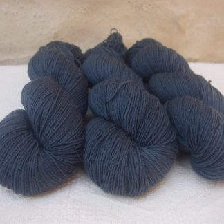 Rainstorm - Mid- to dark bluish grey 4-ply/fingering Peruvian Highland wool sock yarn. Hand-dyed by Triskelion Yarn.