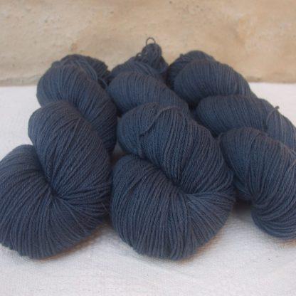 Rainstorm - Mid- to dark bluish grey 4-ply/fingering Peruvian Highland wool sock yarn. Hand-dyed by Triskelion Yarn.