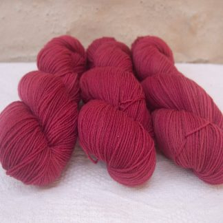 Rose - Vibrant deep rose 4-ply/fingering Peruvian Highland wool sock yarn. Hand-dyed by Triskelion Yarn.