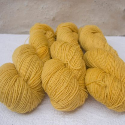 Sol - Light sunny yellow 4-ply/fingering Peruvian Highland wool sock yarn. Hand-dyed by Triskelion Yarn.