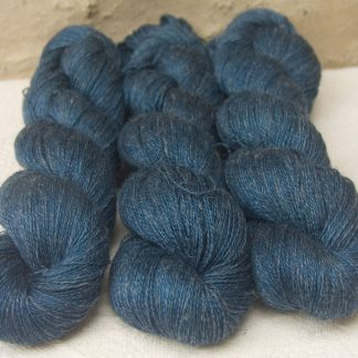 Arawn - Semi-solid to solid deep royal blue Baby Alpaca, silk and linen heavy laceweight yarn. Hand-dyed by Triskelion Yarn.