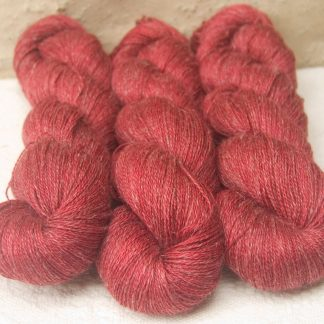 Boötes - Mid- to dark red Baby Alpaca, silk and linen heavy laceweight yarn. Hand-dyed by Triskelion Yarn.