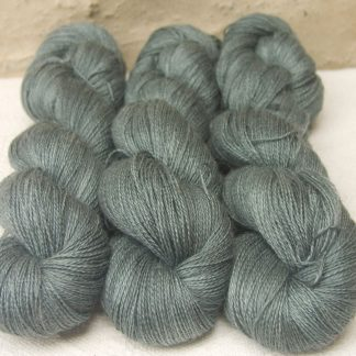Endless Forms - Mid-toned grey with an aqua-green undertone Baby Alpaca, silk and linen heavy laceweight yarn. Hand-dyed by Triskelion Yarn.