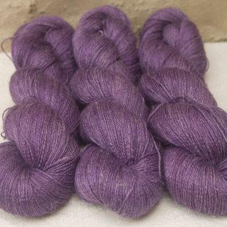 Freo - Semi-solid deep red-violet Baby Alpaca, silk and linen heavy laceweight yarn. Hand-dyed by Triskelion Yarn.