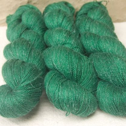 Nemeton - Mid-tone emerald green Baby Alpaca, silk and linen heavy laceweight yarn. Hand-dyed by Triskelion Yarn.