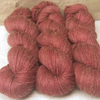 Rose - Vibrant deep rose Baby Alpaca, silk and linen heavy laceweight yarn. Hand-dyed by Triskelion Yarn.