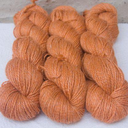 Arcturus - Fresh light to mid orange Baby Alpaca, silk and linen sport weight yarn. Hand-dyed by Triskelion Yarn.