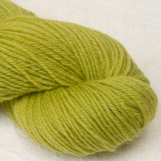 Love, Sings the Spring - Semi-solid chartreuse green, with ochre and spring green tones organic Merino DK/ Double Knit yarn. Hand-dyed by Triskelion Yarn