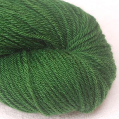 Nemeton - Mid-tone emerald green organic Merino DK/ Double Knit yarn. Hand-dyed by Triskelion Yarn