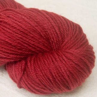 What'll the Neighbours Say? - Semi-solid mid to dark red, with brick and scarlet tones organic Merino DK/ Double Knit yarn. Hand-dyed by Triskelion Yarn