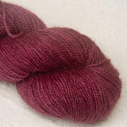 Damson - Mid-tone violet red Bluefaced Leicester (BFL) / Gotland / Wensleydale 4-ply (fingering) weight high-twist sock yarn. Hand-dyed by Triskelion Yarn