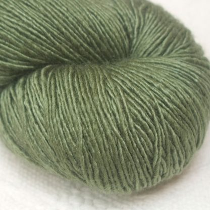 Bodhi – Mid-toned grey-green with a slight olive undertone Falklands Merino and silk blend yarn. Hand-dyed by Triskelion Yarn.