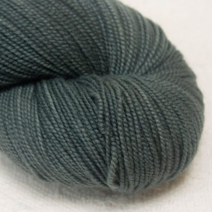 Abyssal - Dark greenish grey extra fine Merino 4-ply / fingering weight yarn. Hand-dyed by Triskelion Yarn.
