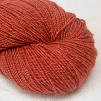 Beach Hut - Light scarlet extra fine Merino 4-ply / fingering weight yarn. Hand-dyed by Triskelion Yarn.