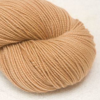Buff - Peachy light brown extra fine Merino 4-ply / fingering weight yarn. Hand-dyed by Triskelion Yarn.