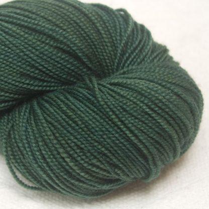 Cypress - Dark blue-green extra fine Merino 4-ply / fingering weight yarn. Hand-dyed by Triskelion Yarn.