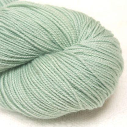 Eau de Nil - Light green extra fine Merino 4-ply / fingering weight yarn. Hand-dyed by Triskelion Yarn.