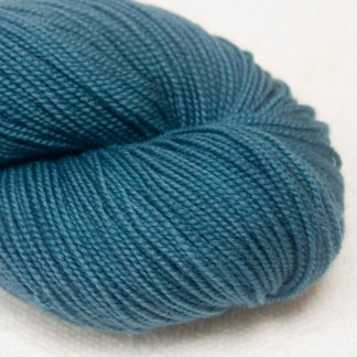Offing - Mid- to dark greyish azure extra fine Merino 4-ply / fingering weight yarn. Hand-dyed by Triskelion Yarn.