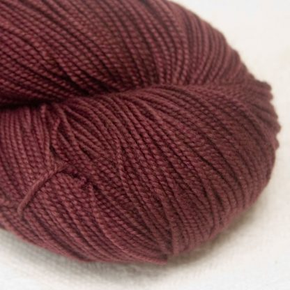 Rosewood - Dark cool red-brown extra fine Merino 4-ply / fingering weight yarn. Hand-dyed by Triskelion Yarn.