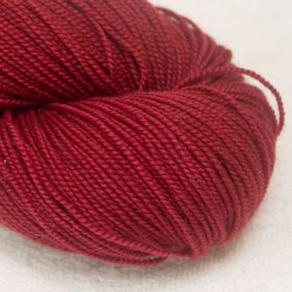 Tea Rose - Deep red extra fine Merino 4-ply / fingering weight yarn. Hand-dyed by Triskelion Yarn.