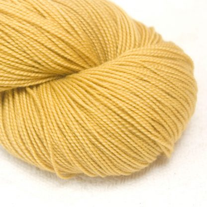 Tuscan Yellow - Warm light to mid yellow extra fine Merino 4-ply / fingering weight yarn. Hand-dyed by Triskelion Yarn.