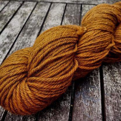 Arcturus - Light orange Bluefaced Leicester (BFL) / Gotland aran weight yarn. Hand-dyed by Triskelion Yarn