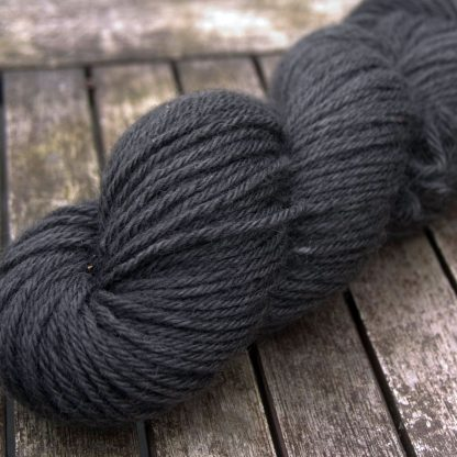 Dark Earth - Mid to dark warm grey Bluefaced Leicester (BFL) / Gotland aran weight yarn. Hand-dyed by Triskelion Yarn