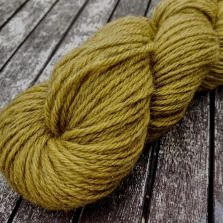 Haystack - Light ochre yellow Bluefaced Leicester (BFL) / Gotland aran weight yarn. Hand-dyed by Triskelion Yarn