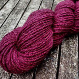 Modraniht - Mid to dark raspberry magenta Bluefaced Leicester (BFL) / Gotland aran weight yarn. Hand-dyed by Triskelion Yarn