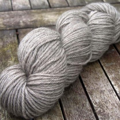 Pebble - Light warm grey Bluefaced Leicester (BFL) / Gotland aran weight yarn. Hand-dyed by Triskelion Yarn