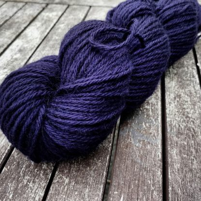 Sloe - Deep violet Bluefaced Leicester (BFL) / Gotland aran weight yarn. Hand-dyed by Triskelion Yarn
