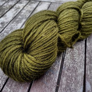 Turning - Mid-tone golden green Bluefaced Leicester (BFL) / Gotland aran weight yarn. Hand-dyed by Triskelion Yarn