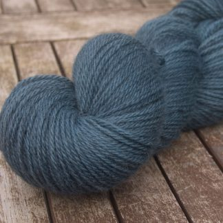 A Giant Turtle's Eyes - Dark grey-blue with a strong turquoise undertone Bluefaced Leicester (BFL) / Gotland dlouble knit (DK) yarn. Hand-dyed by Triskelion Yarn