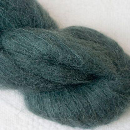 Boreal – Dark spruce green brushed suri alpaca luxury yarn. Hand-dyed by Triskelion Yarn