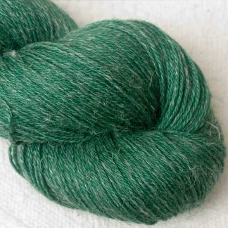 Dinas Emrys - Mid- to dark emerald green Baby Alpaca, silk and linen 4-ply yarn. Hand-dyed by Triskelion Yarn.