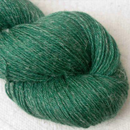 Dinas Emrys - Mid- to dark emerald green Baby Alpaca, silk and linen 4-ply yarn. Hand-dyed by Triskelion Yarn.