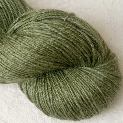 Olive – Mid-tone dull green Baby Alpaca, silk and linen 4-ply yarn. Hand-dyed by Triskelion Yarn.