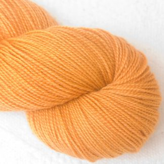 Anemone - Apricot orange Corriedale 4-ply/fingering weight yarn. Hand-dyed by Triskelion Studio.