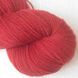 Boötes - Mid- to dark red Corriedale 4-ply/fingering weight yarn. Hand-dyed by Triskelion Studio.