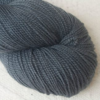 Graphite - Cool, mid-toned grey Corriedale 4-ply/fingering weight yarn. Hand-dyed by Triskelion Studio.
