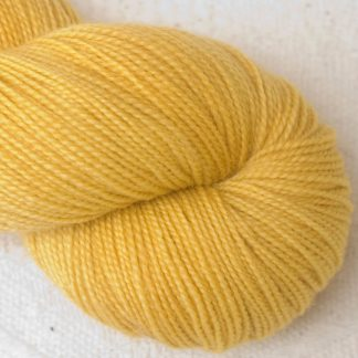 Indian Summer - Light sunny yellow Corriedale 4-ply/fingering weight yarn. Hand-dyed by Triskelion Studio.