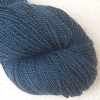 Penumbral - Cool navy blue Corriedale 4-ply/fingering weight yarn. Hand-dyed by Triskelion Studio.