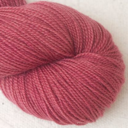 Raspberry Rose - Mid-tone raspberry/rose Corriedale 4-ply/fingering weight yarn. Hand-dyed by Triskelion Studio.