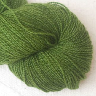 Rum and Laverbread - Semi-solid foliage green, with ochre and olive tones Corriedale 4-ply/fingering weight yarn. Hand-dyed by Triskelion Studio.