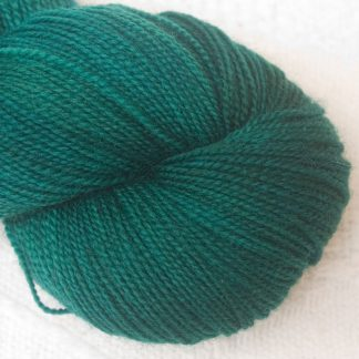 Taiga - Dark coniferous blue/green Corriedale 4-ply/fingering weight yarn. Hand-dyed by Triskelion Studio.